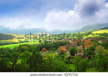 Rural landscape with hills and village in eastern France - stock photo