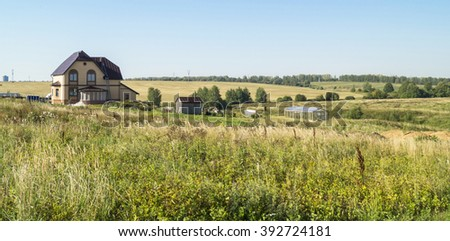 Rural landscape with house on green meadow on background blue sky