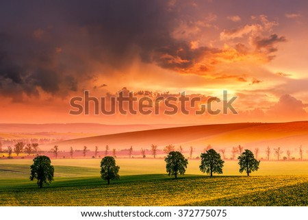 Rural landscape with majestic sky, colorful cloud on sunset