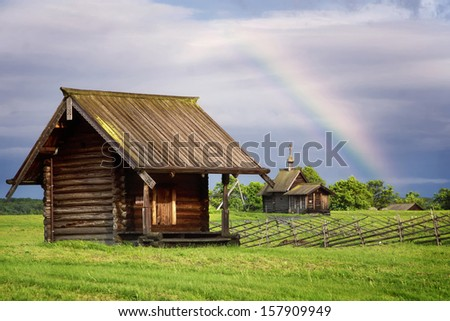 Rural landscape with rainbow. Kizhi Island, Russia - stock photo