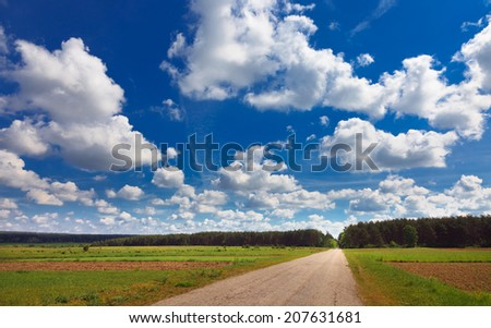 rural landscape with road and incredible clouds