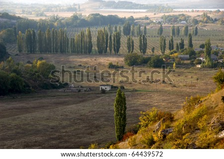 Rural landscape with view of a village and agriculture fields