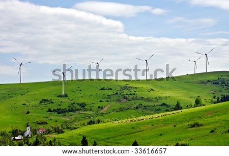 Rural landscape with wind farm - stock photo