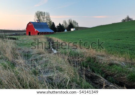 Rural lanscape with red barn, Palouse, Washington State - stock photo