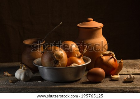 rural life with onions and a ceramic jug - stock photo