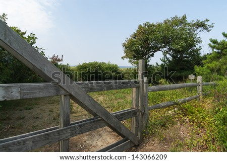 Rural Lot of Land With Wooden Fence and Gate - stock photo