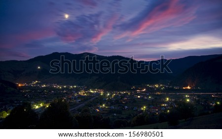 rural night with sunset clouds, Romania - stock photo