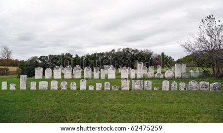 Rural nineteenth century abandoned cemetery - stock photo
