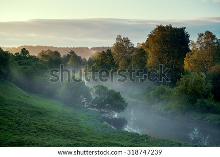 Rural river at sunrise - stock photo