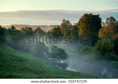 Rural river at sunrise - stock photo