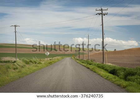 """Rural Road. A seemingly """"road to nowhere"""" seen in the Washington Palouse area in the eastern part of the state.  - stock photo"""
