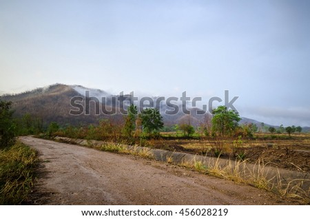 rural road and mountain after raining at tropical country