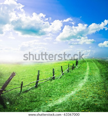 Rural road and sky - stock photo