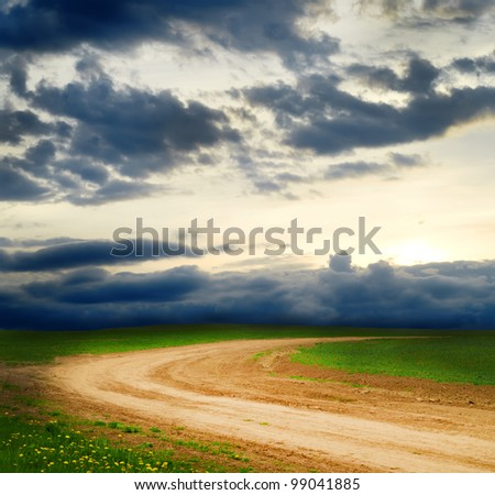 Rural road and the blue sky - stock photo