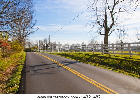 Rural road at late Autumn at countryside. - stock photo