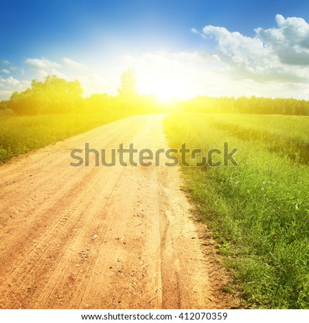 Rural road,blue sky and sunlight. - stock photo