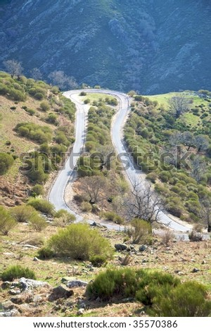 rural road curve at valley of jerte in caceres spain - stock photo