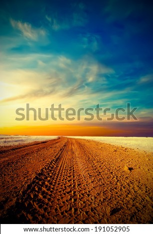 Rural road goes into the sunset. Vintage style - stock photo