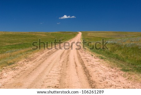 Rural Road in Kansas Prairie - stock photo