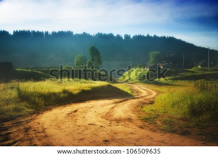 rural road in the summer - stock photo