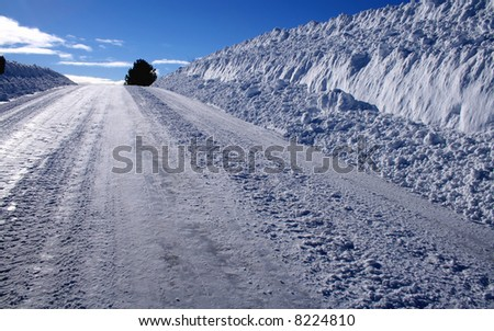 Rural road in winter in central Idaho - stock photo