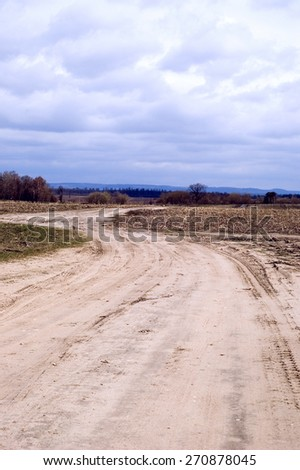 Rural road leaving afar - stock photo