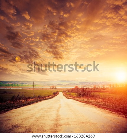 rural road to horizon - stock photo