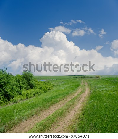 rural road under clouds