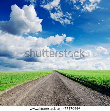 rural road under dramatic sky - stock photo