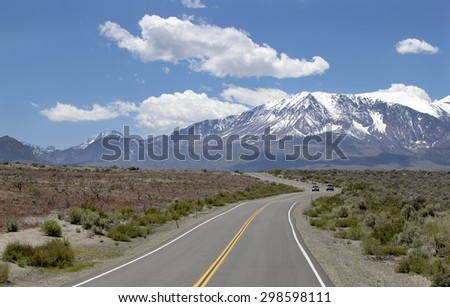 Rural road with snow mountains