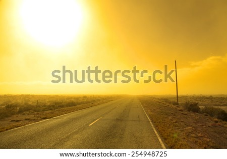 Rural road with sun set in Colorado - stock photo