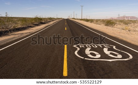 Rural Route 66 Two Lane Historic Highway Transportation Cracked Asphalt