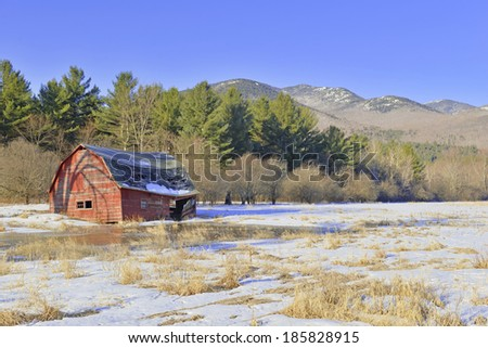 Rural Scene with Old Barn and field in the mountains - stock photo