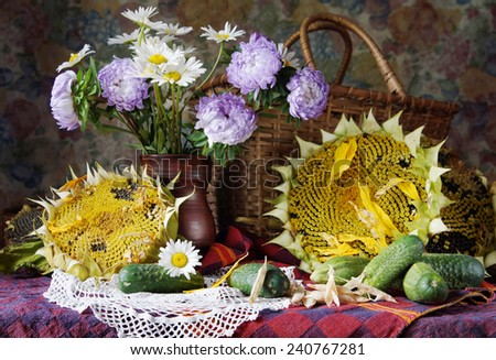 Rural still life with sunflowers and beautiful flowers into a vase - stock photo