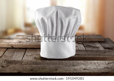 rural table and window with cook hat  - stock photo