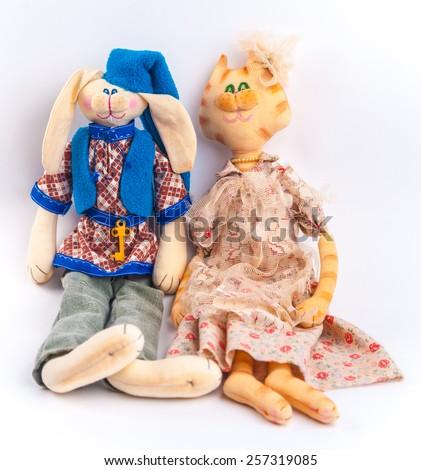 Rural textile dolls couple. Anthropomorphic animals. Bunny and cat. - stock photo