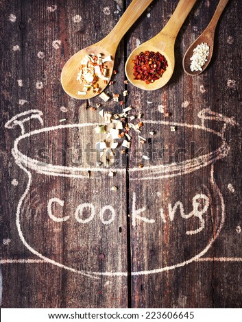 Rural vintage wood kitchen table with drawing bowl and spices for cooking/ cooking idea concept - stock photo