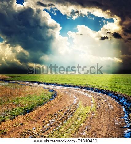 rural way under dramatic sky - stock photo