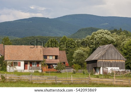 Rural wooden building on a grassland in the mountains of Transylvania, Romania in beautiful environment