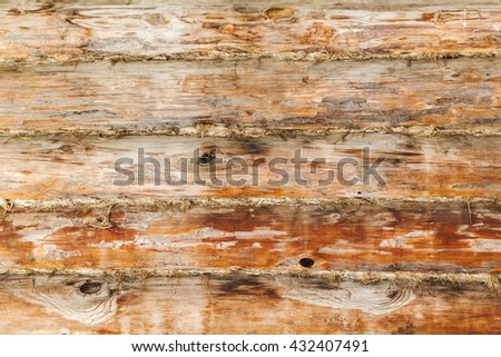 Rural wooden wall made of logs, close-up background photo texture - stock photo