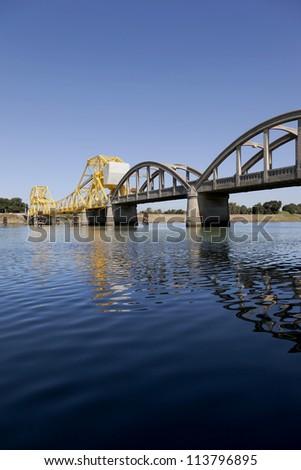 Rural yellow, raising cantilever bridge, Sacramento River, California, USA - stock photo
