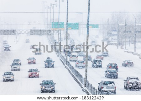 Rush Hour - Blizzard on the Road and bad Visibility - all logo, company and car plate removed or modified. - stock photo