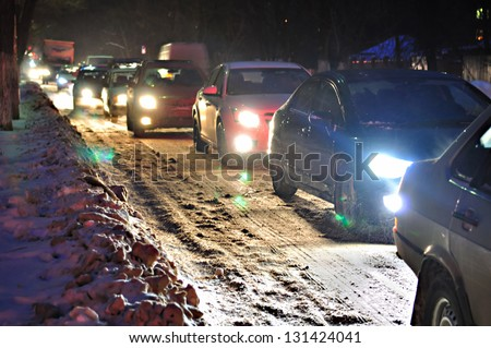 Rush hour in a snow storm - stock photo