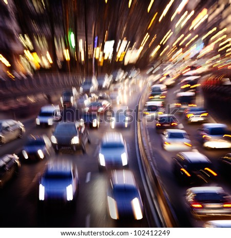 Rush hour in the late afternoon. Motion blur. - stock photo