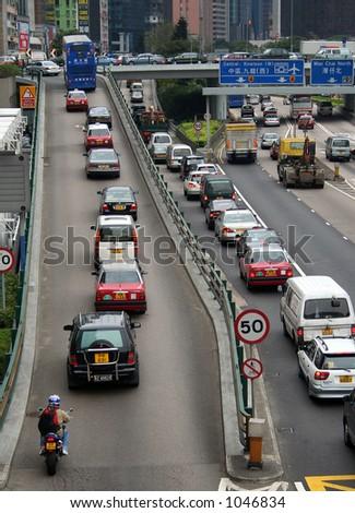Rush hour traffic in downtown Hong Kong - stock photo