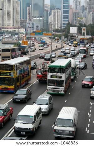 Rush-hour traffic in downtown Hong Kong - stock photo