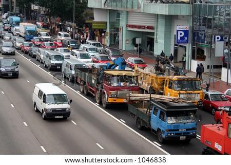 Rush-hour traffic in downtown Hong Kong. - stock photo