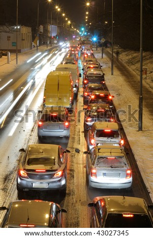 Rush hour traffic lined up car by car on the downtown streets during the evening - stock photo