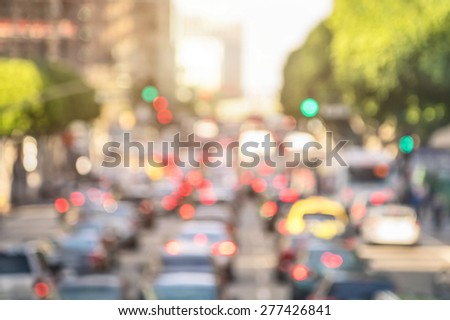 Rush hour with defocused cars and generic vehicles - Traffic jam in Los Angeles downtown - Blurred bokeh postcard of american iconic city with bright daylight colors - Real life transportation concept - stock photo