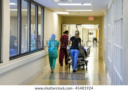 Rushing a patient to the emergency operating room for surgery
